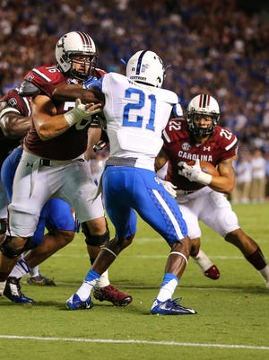 South Carolina Gamecocks offensive tackle Mike Matulis (76) blocks Kentucky Wildcats defensive back Chris Westry (21) for  running back Brandon Wilds (22) during the second half at Williams-Brice Stadium. Kentucky wins 26-22 over South Carolina.