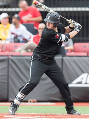 Louisville pitcher Brendan McKay steps up to the plate during the college baseball game between the Louisville Cardinals and the Toledo Rockets at Jim Patterson Stadium.