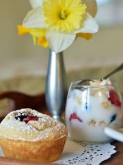 A jam-topped muffin and vanilla yogurt parfait are the sweet elements of mom's meal.
