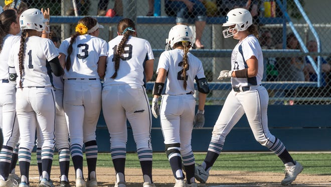 Teammates greet Redwood's Sierra Moffett after her home run against Golden West in a West Yosemite League softball game on Thursday, May 3, 2018.