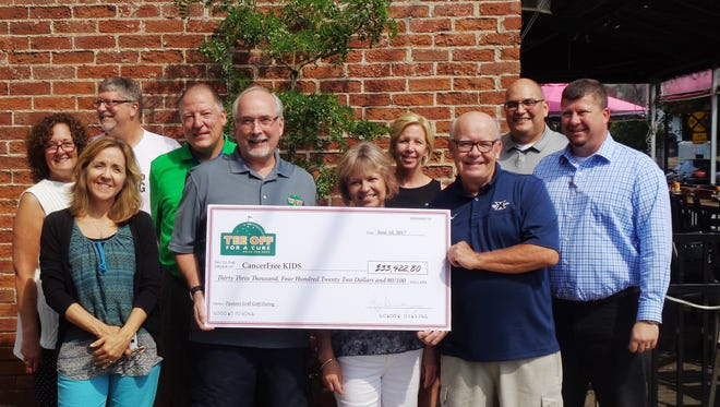 "Committee members and representatives of CancerFree KIDS were on hand at Paxton's Grill July 12 for a check presentation of nearly $34,000 raised at the ""Tee Off For a Cure"" golf outing: Alice Hoffer and Karen Cornett from CFK along with committee members Doug Ransom, Steve Max, Mark Money, Mary Baugh, CeeCee Collins, Ralph Dunnigan, Bill Re, and Jeff Hollingsworth are pictured."