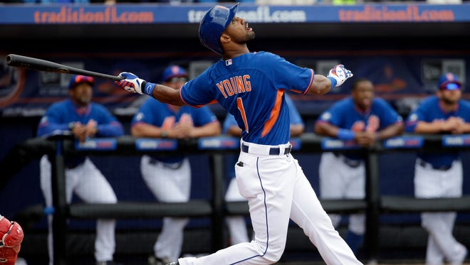 New York Mets' Chris Young plays in an exhibition spring training baseball game against the Washington Nationals, Thursday, March 27, 2014, in Port St. Lucie, Fla.
