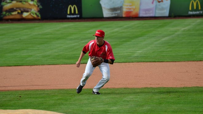 Infielder Christian Lichtenthaler, a West Albany High School graduate, warms up before a Volcanoes game last week. Lichtenthaler was an undrafted signee of the San Francisco Giants this year.