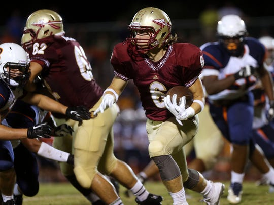 Riverdale's Austin Bryant rushes against Blackman in a game last month.