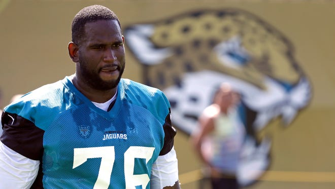 Jacksonville Jaguars offensive lineman Branden Albert arrives at practice during NFL football training camp, in Jacksonville, Florida, on Friday. Albert, a Rochester native and two-time Pro Bowl selection, announced his retirement on Monday.