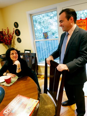 John Cranley talks to his wife, Dena, before leaving for work.