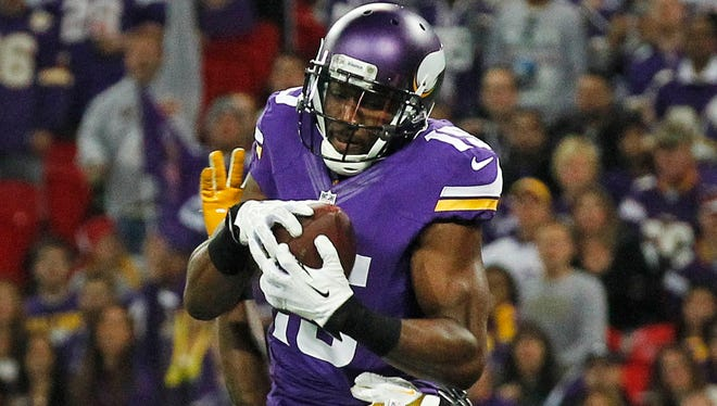 Vikings wide receiver Greg Jennings catches a touchdown pass in front of Steelers cornerback Cortez Allen during their game at Wembley Stadium in London.