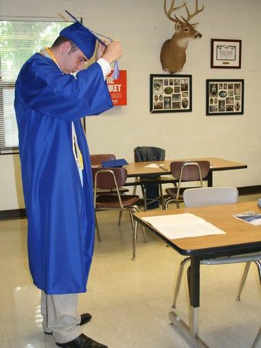 Cotter Valedictorian Dalton Orsborn adjusts his mortar