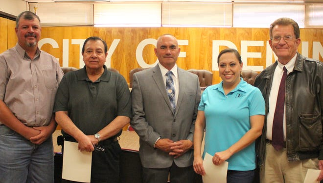 "City of Deming public servants were sworn-in last week following Deming's Municipal Election. On hand for the oath of office in the City Council Chambers were, from left, City Administrator Aaron Sera, Joe ""Butter"" Milo, City Council District 3; Mayor Benny Jasso, Roxana Rincon, City Council District 2; and Municipal Court Judge Frank Van Gundy."
