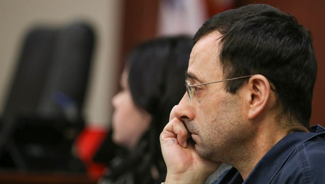Larry Nassar listens to victim impact statements during the first day of the hearing in Lansing, Mich. on Jan. 16, 2018.