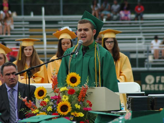 "Graduate Duane Joseph Olson performed ""America the Beautiful"" during a salute to the United States Armed Services at the Franklin D. Roosevelt High School commencement ceremony on Saturday in Hyde Park."