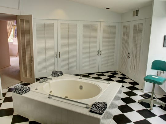 Behind the dual sinks in the master bathroom is a private staircase, which leads to the back door and garage. Listing agent Eric Meeks described the hidden room as one of his favorite features.