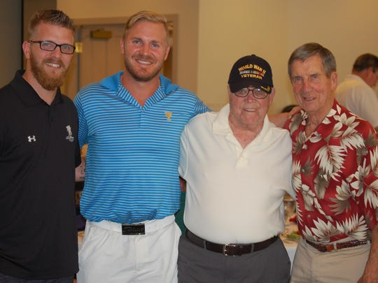 Among those attending the golf outing were (from left) Wounded Warrior Project speaker Deven Schei, James Wisniewski of the Carolina Hurricanes, Ed Wisniewski and former Detroit Red Wings great Ted Lindsay.