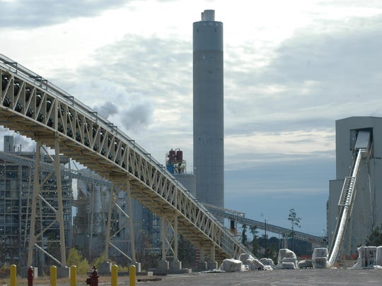 A conveyor carries petroleum coke from the Red River to CLECO's Madison 3 power plant near Boyce.