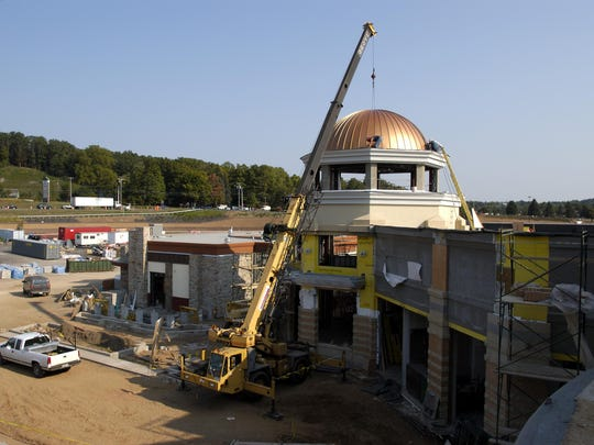 """Crews work on the """"front expansion"""" of Eastview Mall in 2003."""