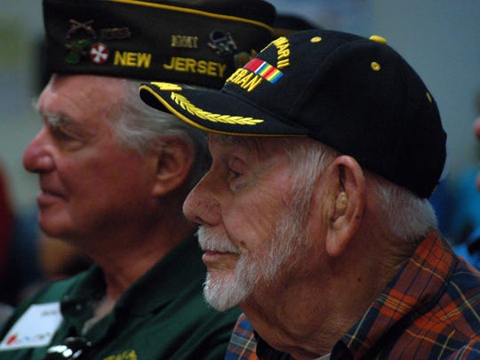 Robert Schemel, right, who was with the Army Air Corps in Europe during WWII, listens to Tommie Barfield Elementary School singers along with veteran US Army Sergeant Daniel Kashey at last year's presentation at the school. This year's ceremony at the school will be on Friday, Nov. 6.