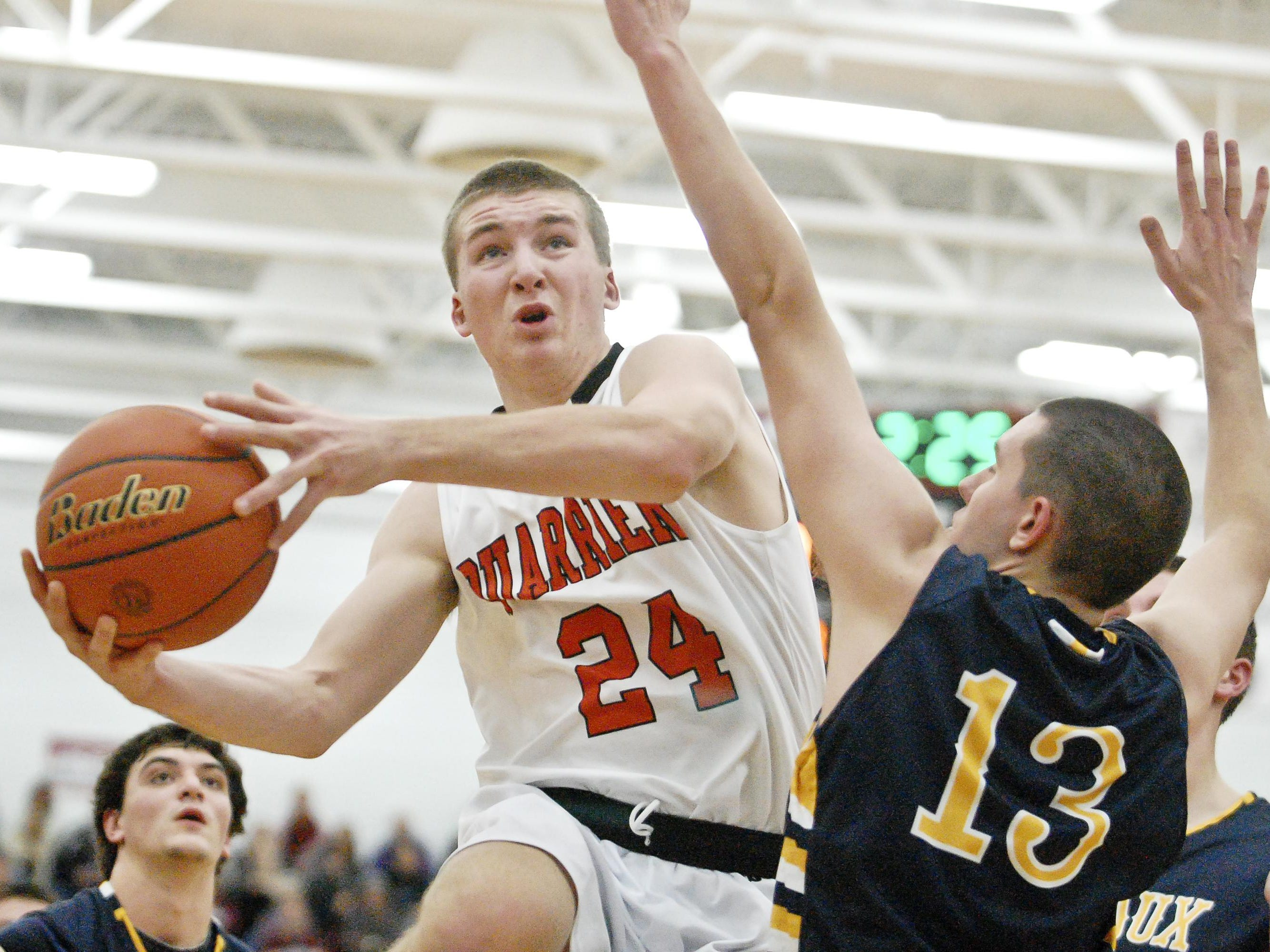 Ty Hoglund of Dell Rapids leaps toward the basket Dec. 31 against Sioux Valley at Brookings. Hoglund surpassed 1,000 career points in the first game of the season, set a school record for most points scored in the next game and led the Quarriers with 26.3 points per game.