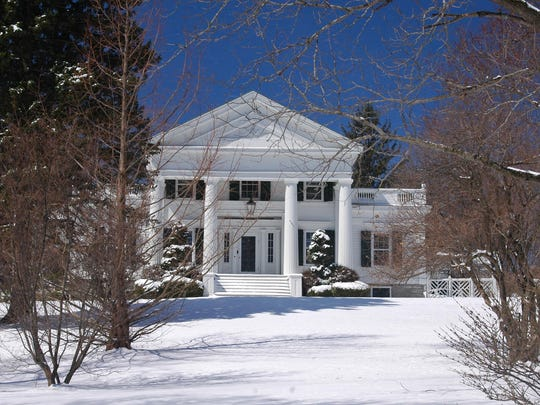 Captured in winter, the distinctive Greek Doric columns on the large front portico of the 1839 Pulver-Bird house on Hunns Lake Road in Stanfordville reflect the prominence and success of its owner, farmer Henry Pulver.
