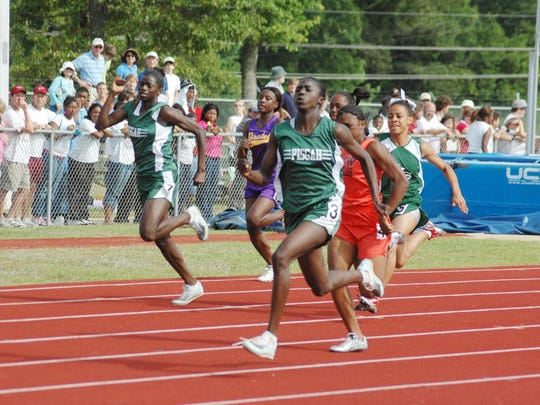 Former Pisgah standouts Tori Bowie, right, and sister Tamarra, far left, finish the 100 meters first and second, respectively. Tori Bowie will be competing in the Olympics in Rio this month.