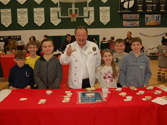 "Chef Joe Massaglia with Atlantic Christian School students at the Bowls of Hope Judge's Table on Feb. 6 where he sampled 15 soups and picked his favorite to receive the ""Chef's Souper Soup Award"" – Sal's Café's New England Clam Chowder."