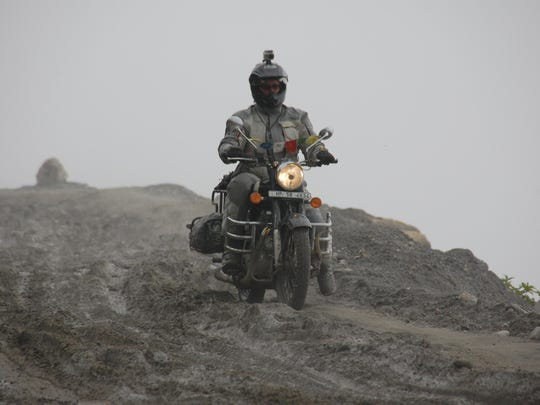Clickenger rides her motorcycle in India. She operates Women's Motorcycle Tours, which conducts motorcycle rides exclusively for women and estimates she's traveled more than 250,000 miles on motorcycles.