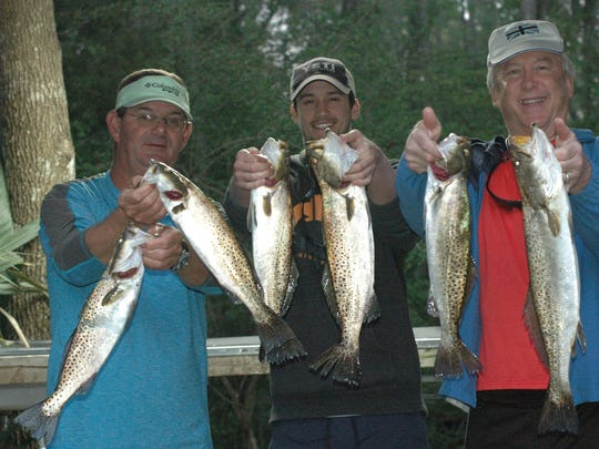 Capt. Junior Dice, Andrew Baker, and Jeff Griggs with some of the trout they caught this past week fishing with Dice.