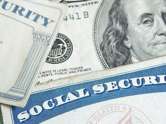 Social Security card with hundred dollar bill