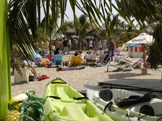 BEFORE SANDY: Beachgoers enjoy Donovan's Reef in Sea Bright on a sunny day. In past years, the bar hosted luminaries such as Bruce Springsteen and Jon Bon Jovi.