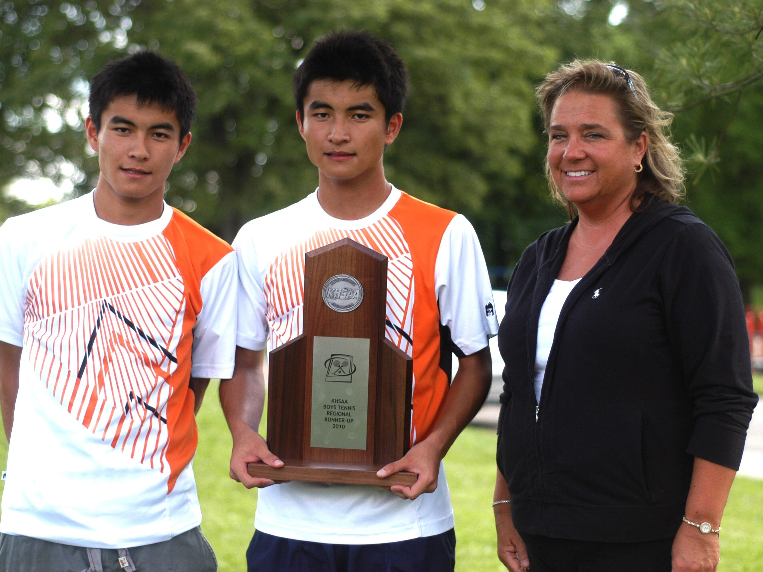 Coach Amy Bates, right, shown with the Okitas, has 31 players for Ryle tennis this year.