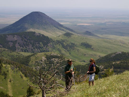 Hikers enjoy the Sweet Grass Hills. The Sweet Grass Hills are one of a dozen wilderness walks offered along the Hi-Line this summer.