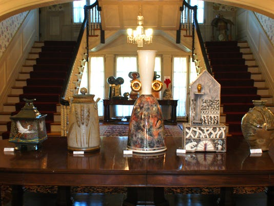 Ceramics by Indiana artists in the entry to the Haan Museum.jpg