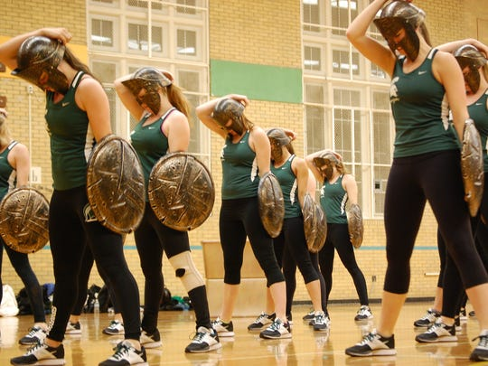 """The MSU Pompon squad wears its masks and shields during practice of its """"Spartan Strong"""" routine, set to music inspired by the soundtrack from the 2006 movie, """"300."""""""