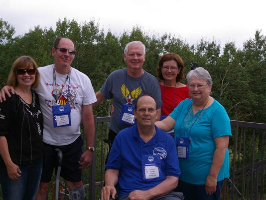 Stroke survivors and caregivers enjoying each others' company at camp.jpg