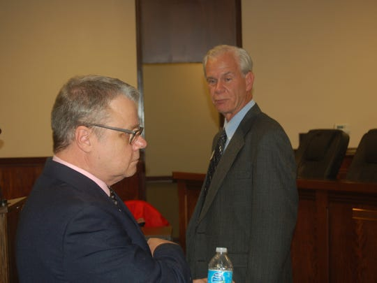 Frank Wallis (left) and Bob Devecki cross paths prior to the mayoral candidate meeting at Mountain Home City Hall on Monday.