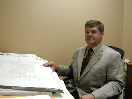 Chip Moore has signed a settlement agreement with the City of Hendersonville.