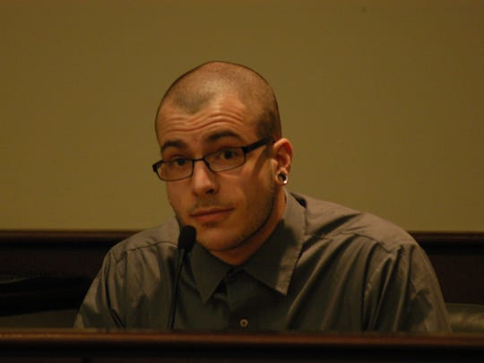 Josh Davis testifies during his brother's trial on Tuesday.