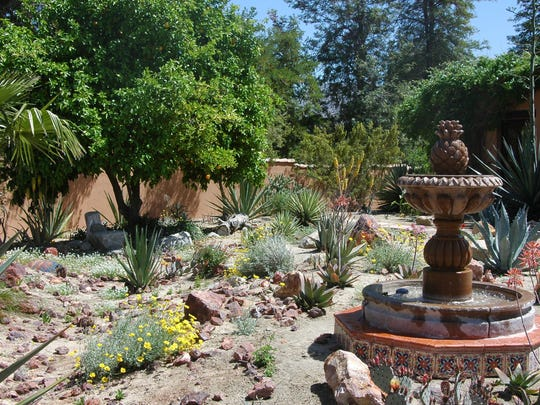 A garden on the 2014 tour featuring great solutions for space after lawn removal.