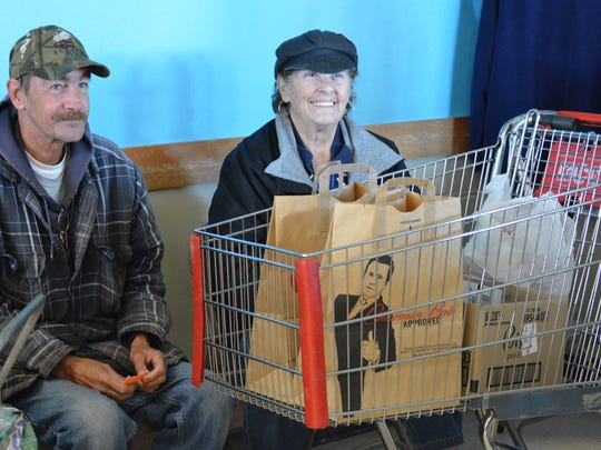 Brian Hovet and Ramona Aly of Wausau fill a grocery cart with food twice each week and take it back to their apartment building for people without the transportation or physical mobility to make it to the Salvation Army of Marathon County's food pantry.