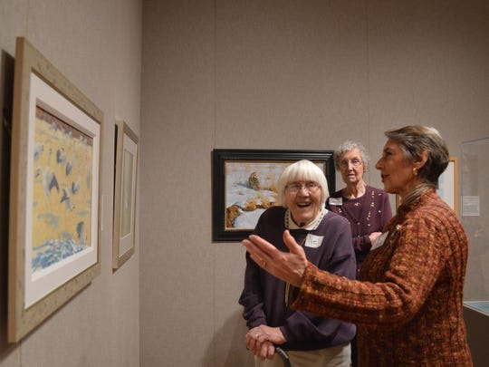 Pamela Frary tells Gayla Marco and Nel Gibbs about a piece in the Birds in Art exhibit during a tour at the Woodson Art Museum on Sunday, Nov. 16, 2014.