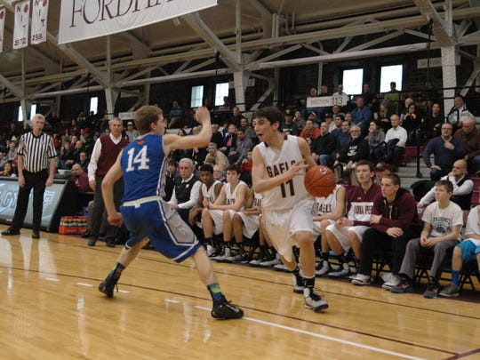 Iona Prep junior guard Ty Jerome looks to drive around Archbishop Molloy's Jason Camus during Sunday's game at Fordham University. Jerome scored 26 points in the Gaels' win.