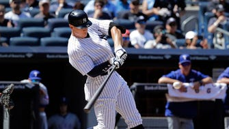 Aaron Judge connects for a solo home run against the Rangers on Saturday at Yankee Stadium.