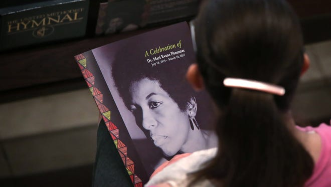 A photo of Mari Evans looks up from a program during the Celebration of Life memorial for Dr. Mari Evans Phemster, held at St. Luke's United Methodist Church, Monday, March 20, 2017.
