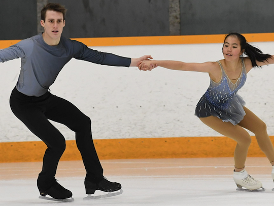 Sarah Feng and TJ Nyman skate during the Junior Division