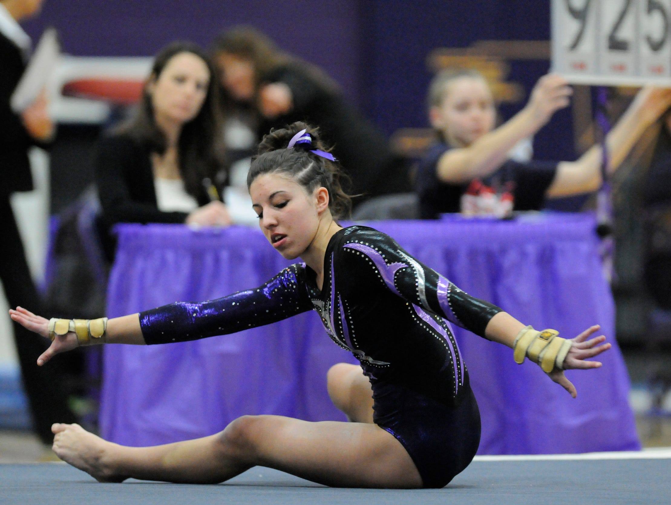 Lydia Butkowski of Melrose starts her floor routine during the Class A state gymnastics true team competition on Jan. 24 in Melrose.
