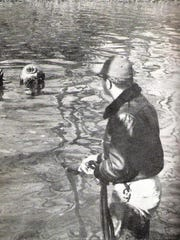 Divers looking for the Henning nickels.