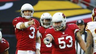 Arizona Cardinals quarterback Carson Palmer (3) and center A.Q. Shipley (53) communicate  against the Washington Redskins  during their NFL game Sunday, Dec. 4, 2016 in Glendale, Ariz.