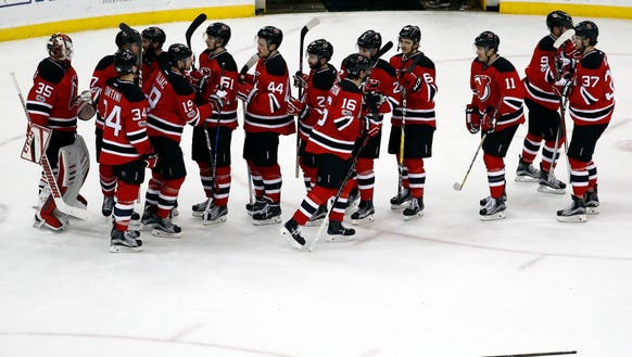 New Jersey Devils players celebrate after beating the