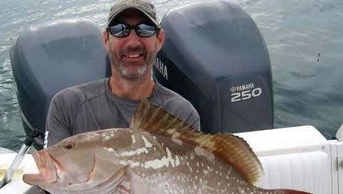 Greg Grimes with a 27-inch red grouper, the largest of three keepers he and friends caught 15 miles west of New Pass Saturday on an offshore Fishbuster Charter.