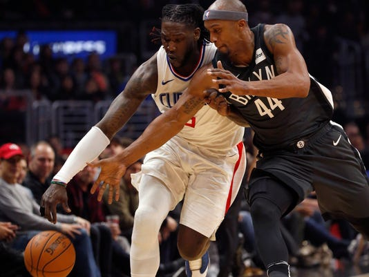 Los Angeles Clippers forward Montrezl Harrell, left, and Brooklyn Nets forward Dante Cunningham battle for the ball during the first half of an NBA basketball game, Sunday, March 4, 2018, in Los Angeles. (AP Photo/Ringo H.W. Chiu)