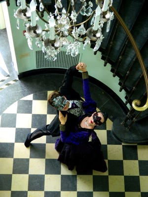 """Director Stirling Matheson and Company Dancer Emma Beigel of the Ballet Theatre of Indiana perform """"A Masque of Red Death"""" as part of the company's fall show, """"Macabre: A Night of Edgar Allen Poe Poems."""""""